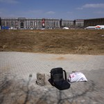 A chair lies on a deserted field that was once part of the stadium where the 2008 Olympic Games baseball competition was held. Picture: REUTERS/David Gray