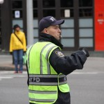 Traffic cops directing traffic amid power failures in Downtown Manhattan.