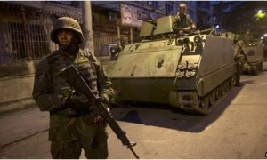 Hundreds of Brazilian security officers, backed by armoured vehicles and helicopters, have occupied 12 shanty towns in Rio de Janeiro. Source: AP