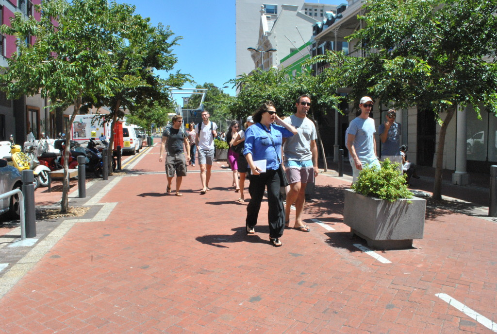 Participants on Future Cape Town's 'Design a Liveable City' walking tour meander down Waterkant Street.