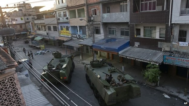Rio: The armoured vehicles moved into the Mare slum at dawn. Photo: AP
