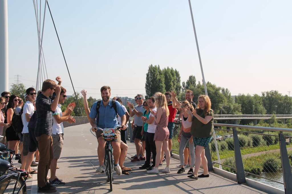 The author cycling across the Nescio Bridge with classmates from the course