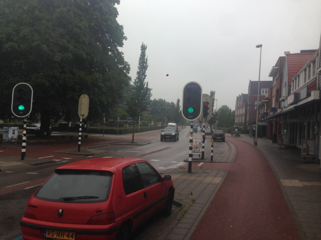 The suburbs of Amsterdam where parked cars protect cyclists from moving cars rather unlike the case of all such lanes here