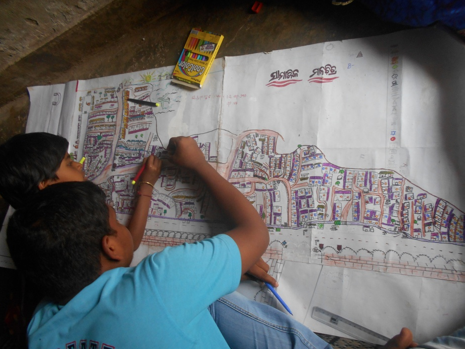 Young mapmakers sketch out the changes they would like to see in their communities. photo: Humara Bachpan